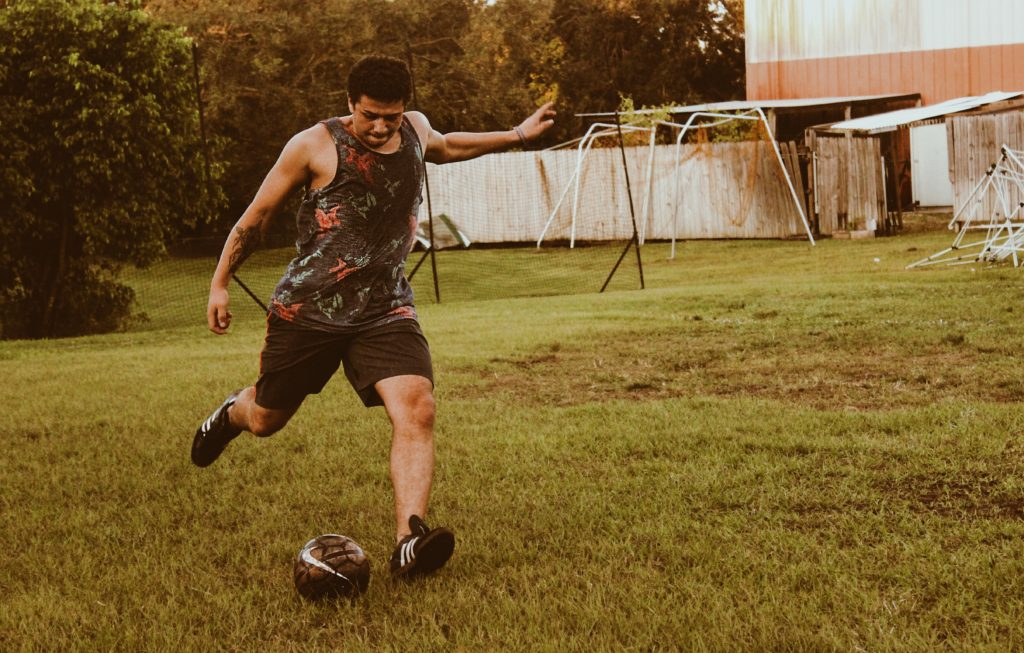 Photo of man kicking a ball