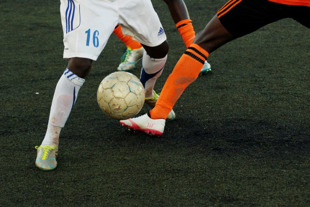 Photo of two players playing football