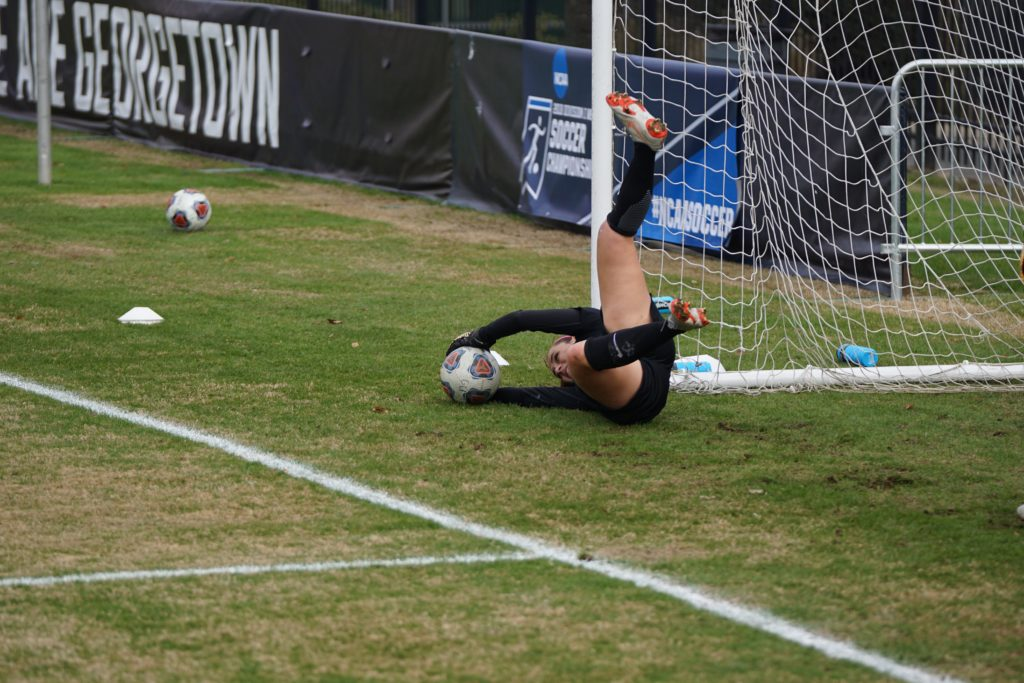 Photo of a keeper catching a ball