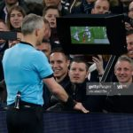 Referee Bjorn Kuipers checks the VAR screen before awarding a penalty for a hand ball by Tottenham Hotspur's English defender Danny Rose during the UEFA Champions League quarter-final first leg football match between Tottenham Hotspur and Manchester City at the Tottenham Hotspur Stadium in north London