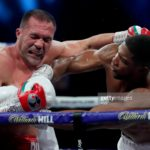 Anthony Joshua punches Kubrat Pulev during the IBF, WBA, WBO and IBO World Heayweight Title fight between Anthony Joshua and Kubrat Pulev at The SSE Arena, Wembley on December 12, 2020 in London, England.